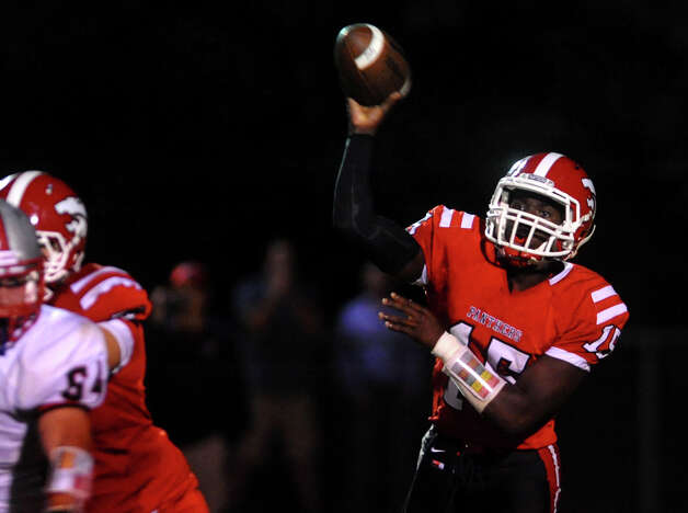 Masuk QB Malik Cummings passes the ball, during boys football action against Pomperaug in Monroe, Conn. on Friday September 14, 2012. Photo: Christian Abraham / Connecticut Post