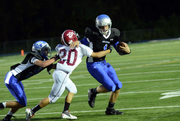Bunnell ball carrier Ronald Rossomano (1) fends off Bethel's James Giannone (20) during the first football game of the season at Bunnell High School in Stratford on Friday, Sept. 14, 2012. Photo: Amy Mortensen / Connecticut Post Freelance