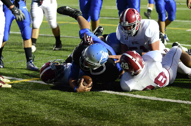 Bunnell ball carrier Ronald Rossomano (1) gets the ball over the goal line for a touchdown during the first football game of the season against Bethel at Bunnell High School in Stratford on Friday, Sept. 14, 2012. Photo: Amy Mortensen / Connecticut Post Freelance