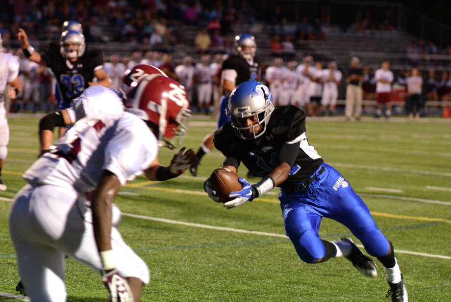 Bunnell ball carrier Justin Townsend (11) runs for yardage during the first football game of the season against Bethel at Bunnell High School in Stratford on Friday, Sept. 14, 2012. Photo: Amy Mortensen / Connecticut Post Freelance