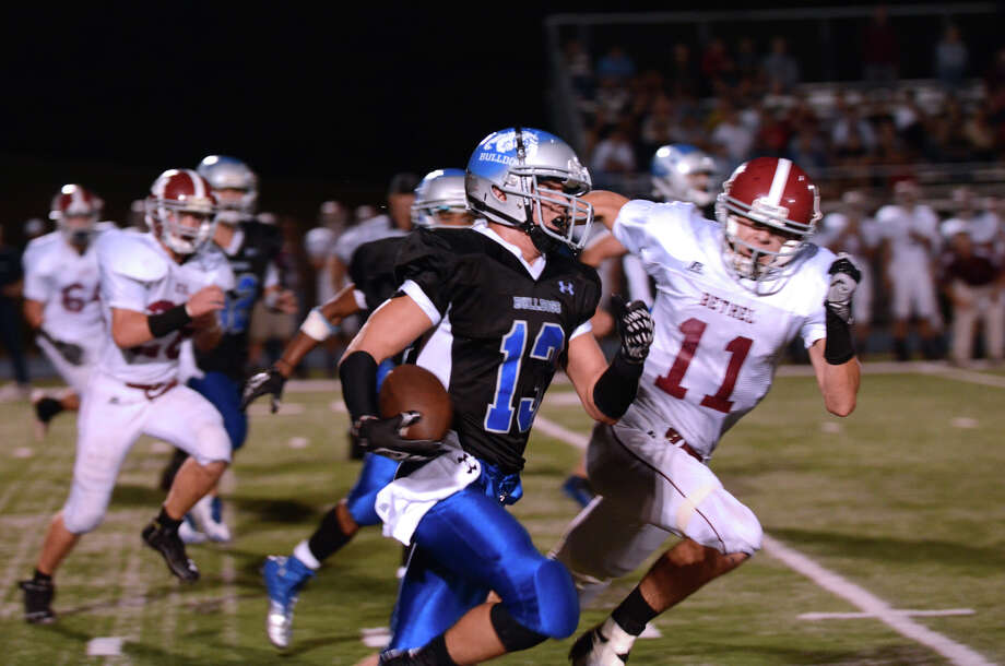 Bunnell's Andrew Calzone (13) carries the ball during the first football game of the season against Bethel at Bunnell High School in Stratford on Friday, Sept. 14, 2012. Photo: Amy Mortensen / Connecticut Post Freelance