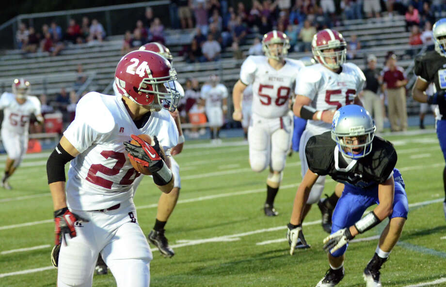 Bethel's Nick Silva (24) carries the ball during the first football game of the season against Bunnell at Bunnell High School in Stratford on Friday, Sept. 14, 2012. Photo: Amy Mortensen / Connecticut Post Freelance