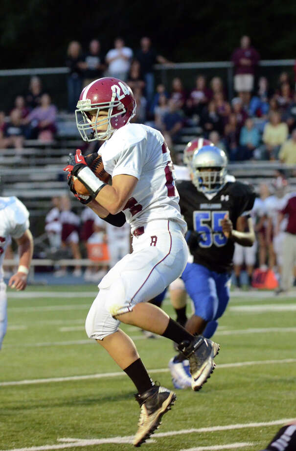 Bethel's Nick Silva jumps up to receive a pass during the first football game of the season against Bunnell at Bunnell High School in Stratford on Friday, Sept. 14, 2012. Photo: Amy Mortensen / Connecticut Post Freelance