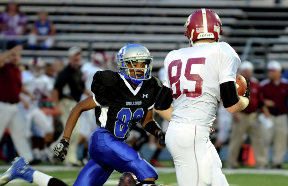 Bunnell's Devante Teel (80) defends against Bethel ball carrier Calvin Daniels (85) during the first football game of the season against Bethel at Bunnell High School in Stratford on Friday, Sept. 14, 2012. Photo: Amy Mortensen / Connecticut Post Freelance