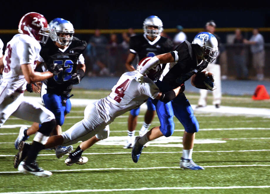 Bunnell Nolan Aurelia (6) carries the ball as Bethel's Nick Silva (24) defends during the first football game of the season at Bunnell High School in Stratford on Friday, Sept. 14, 2012. Photo: Amy Mortensen / Connecticut Post Freelance