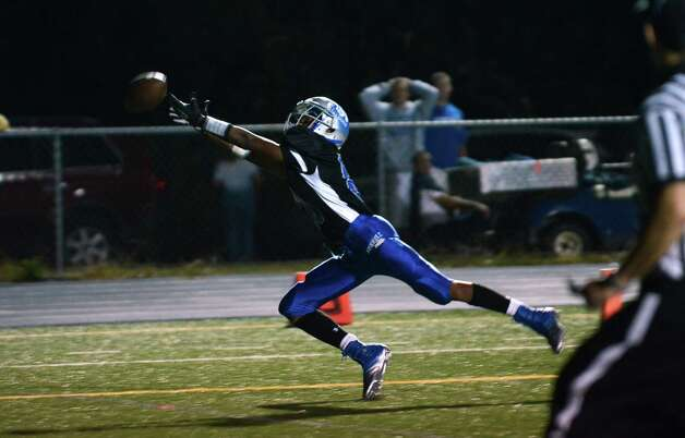 The pass is just out of reach for Bunnell's Devante Teel (80) during the first football game of the season against Bethel at Bunnell High School in Stratford on Friday, Sept. 14, 2012. Photo: Amy Mortensen / Connecticut Post Freelance
