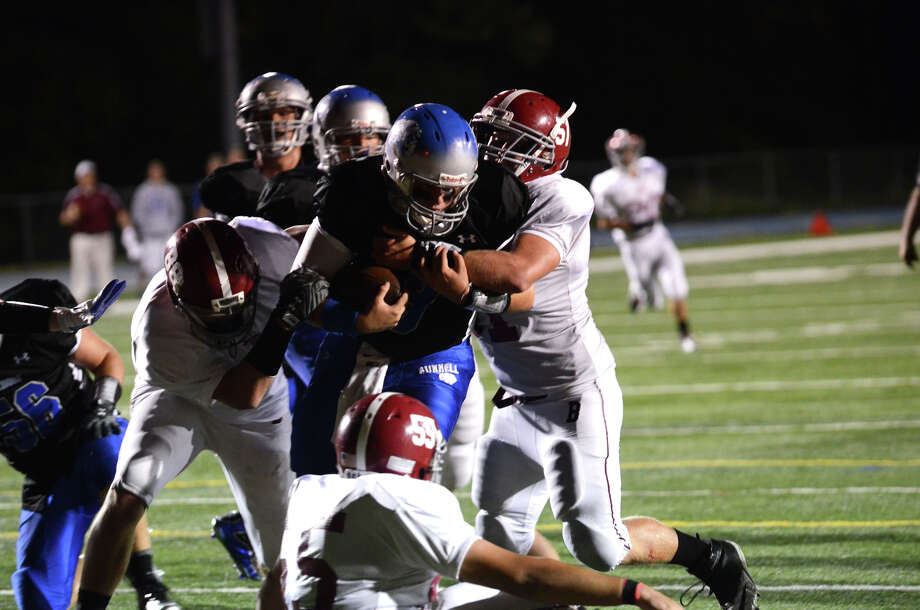 Bethel defense piles on Bunnell's quarterback Bryan Castelot (9) during the first football game of the season at Bunnell High School in Stratford on Friday, Sept. 14, 2012. Photo: Amy Mortensen / Connecticut Post Freelance