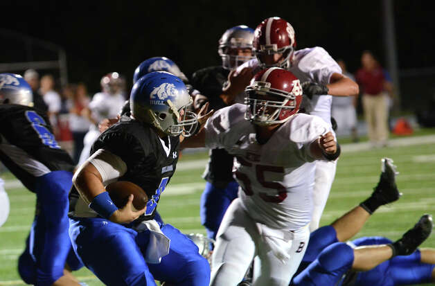 Bunnell's quarterback Bryan Castelot (9) defends against Bethel's John Dias (55) during the first football game of the season at Bunnell High School in Stratford on Friday, Sept. 14, 2012. Photo: Amy Mortensen / Connecticut Post Freelance