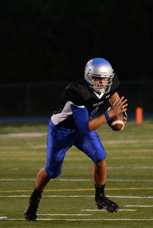 Bunnell ball carrier Ronald Rossomano (1) during the first football game of the season against Bethel at Bunnell High School in Stratford on Friday, Sept. 14, 2012. Photo: Amy Mortensen / Connecticut Post Freelance