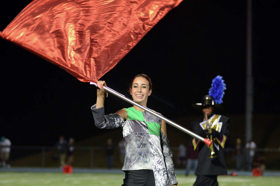 The Bunnell color guard and marching band perform during the first football game of the season against Bethel at Bunnell High School in Stratford on Friday, Sept. 14, 2012. Photo: Amy Mortensen / Connecticut Post Freelance