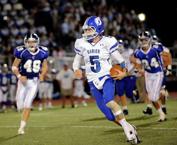 Darien high school quarterback Henry Baldwin picks up some yardage against Fairfield Ludlowe high school during the first football game of the 2012 season held at Fairfield Ludlowe high school, Fairfield, CT on Friday September 14th 2012 Photo: Mark Conrad / Connecticut Post Freelance