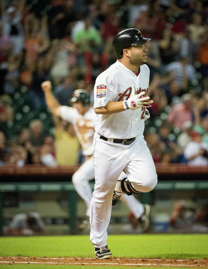 Sept. 1: Astros 2, Reds 1 Jose Altuve runs for first while Matt Downs heads home with the winning run as Altuve's bases-loaded grounder went through the legs of Wilson Valdez to cap a two-out rally in the bottom of the ninth inning.Record: 41-92. (Smiley N. Pool / Chronicle) Photo: Smiley N. Pool, Houston Chronicle / © 2012  Smiley N. Pool