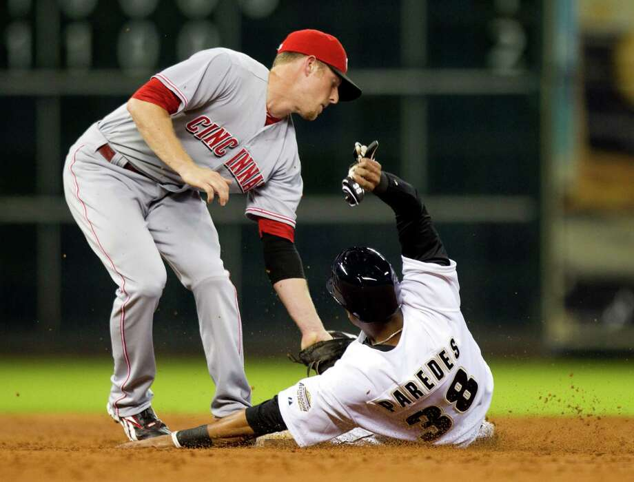 Aug. 31: Reds 9, Astros 3Cincinnati Reds shortstop Zack Cozart tags Houston Astros shortstop Jimmy Paredes out at second on an attempted steal during the third inning.Record: 40-92. Photo: Brett Coomer / © 2012 Houston Chronicle