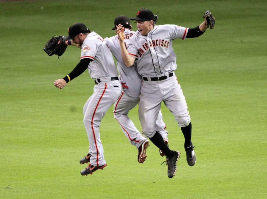 Aug. 30: Giants 8, Astros 4Giants outfielders Gregor Blanco, Angel Pagan and Hunter Pence celebrate their victory. Pence was a big part of the Giants' comeback win connecting on the go-ahead single in the seventh inning.Record: 40-91. Photo: Billy Smith II, Houston Chronicle / © 2012 Houston Chronicle
