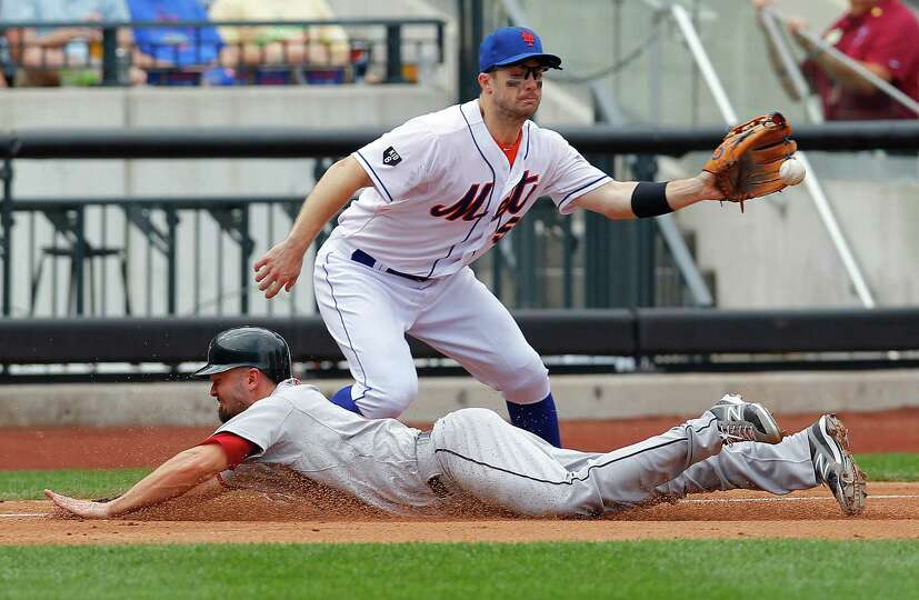 Aug. 25: Mets 3, Astros 1 Scott Moore slides into third base safely as he ad