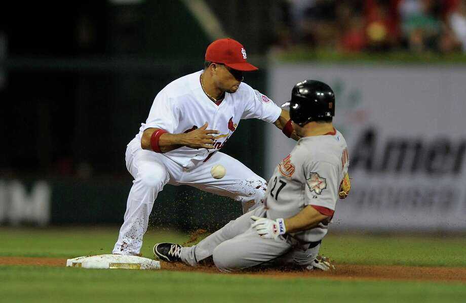 Aug. 22: Cardinals 4, Astros 2Rafael Furcal of the Cardinals can't handle the throw as Jose Altuve of the Astros slides in for a double.Record: 39-85. Photo: Jeff Curry, Getty Images / 2012 Getty Images