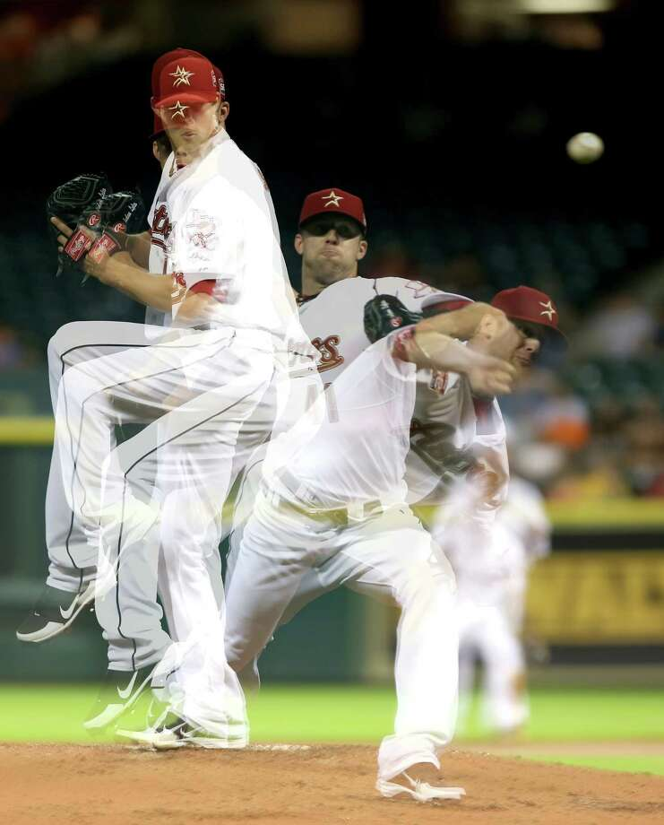 Aug. 18: Diamondbacks 12, Astros 4(EDITORS NOTE: Multiple exposures were combined in camera to produce this image.) Jordan Lyles pitches against the Arizona Diamondbacks in the third inning.Record: 39-82. Photo: Thomas B. Shea / 2012 Getty Images