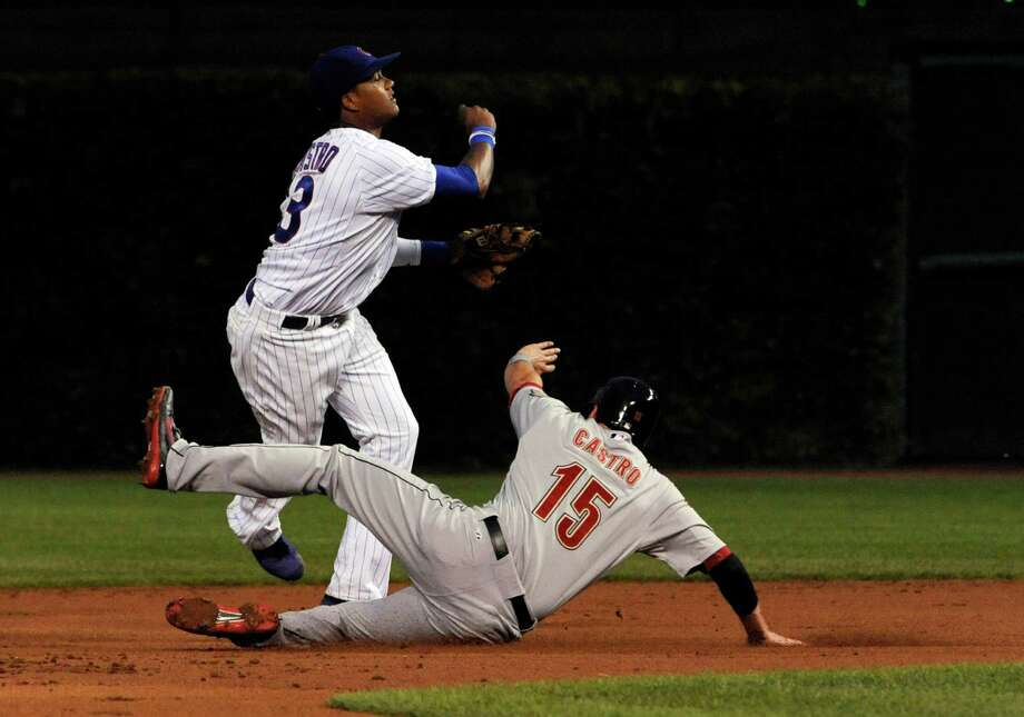 Aug. 13: Cubs 7, Astros 1 Jason Castro tries to take out Starling Castro and break up a double play in the second inning.Record: 38-79. Photo: David Banks, Getty Images / 2012 Getty Images