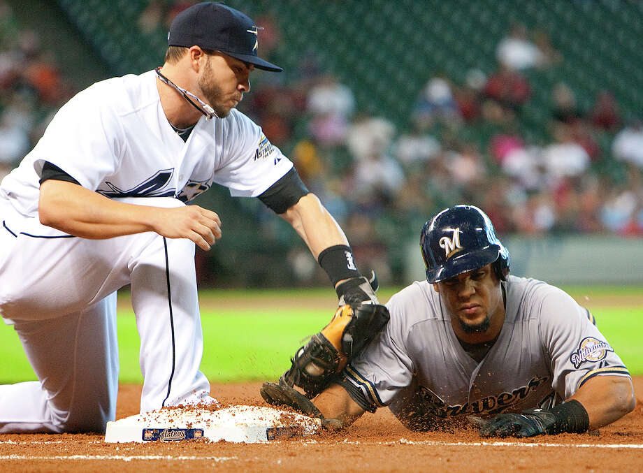 Aug. 12: Brewers 5, Astros 3 Astros first baseman Steve Pearce tries to tag Brewers center fielder Carlos Gomez on a pickoff attempt.Record: 38-78. (Cody Duty / Chronicle) Photo: Cody Duty, Houston Chronicle / © 2011 Houston Chronicle
