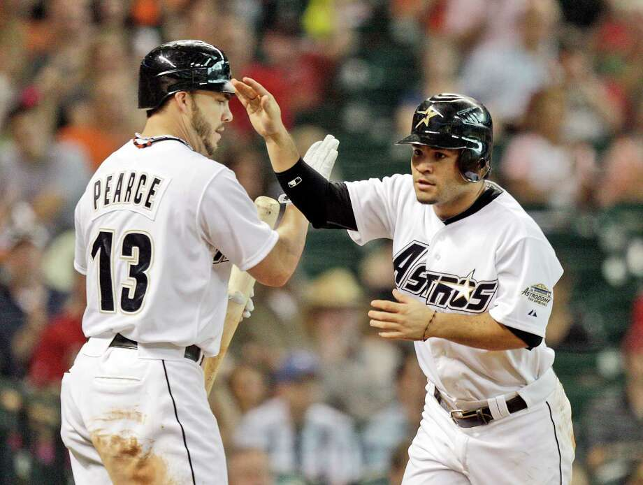 Aug. 11: Astros 6, Brewers 5 Jose Altuve high five's Steve Pearce after scoring on a fielding error by right fielder Norichika Aoki of the Milwaukee Brewers.Record: 38-77. Photo: Bob Levey / 2012 Getty Images