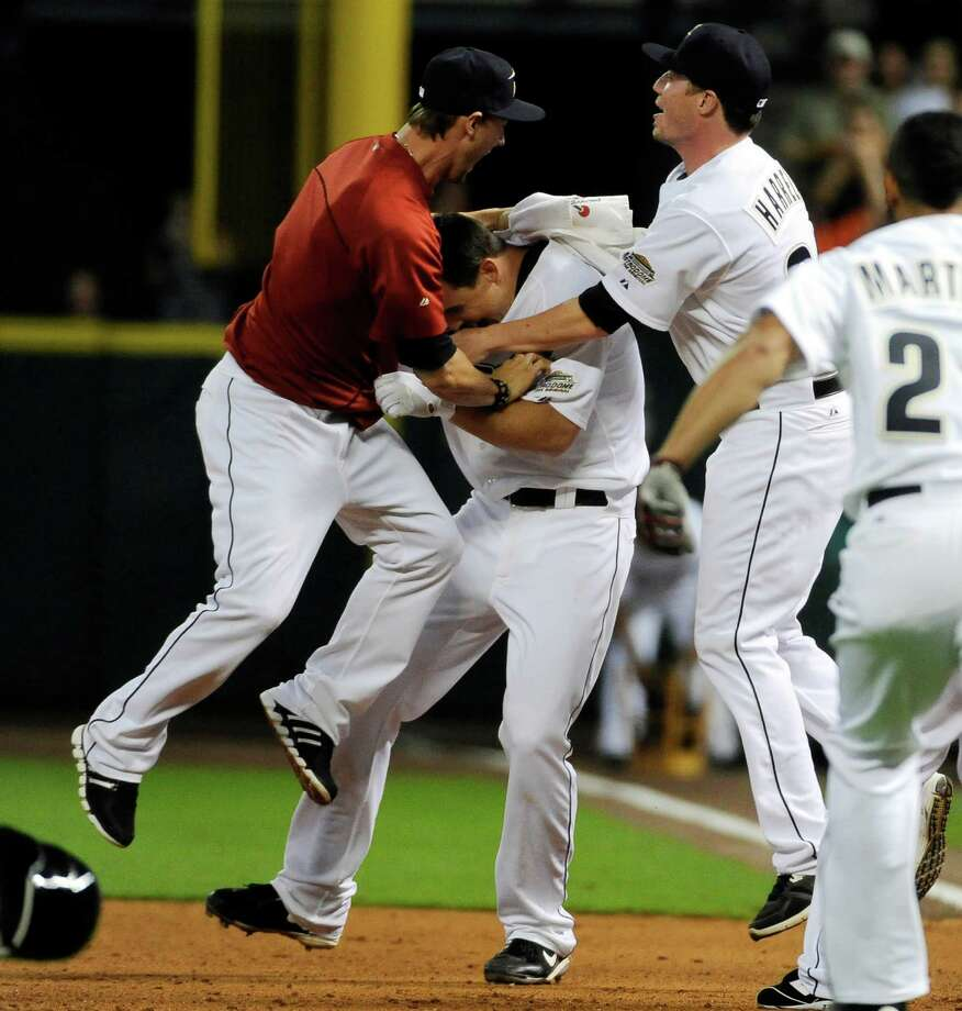 Aug. 10: Astros 4, Brewers 3 Brian Bogusevic, center, is mobbed by teammates after hitting a walk-off single in the ninth inning, driving in Steve Pearce.Record: 37-77. Photo: Pat Sullivan, Associated Press / AP