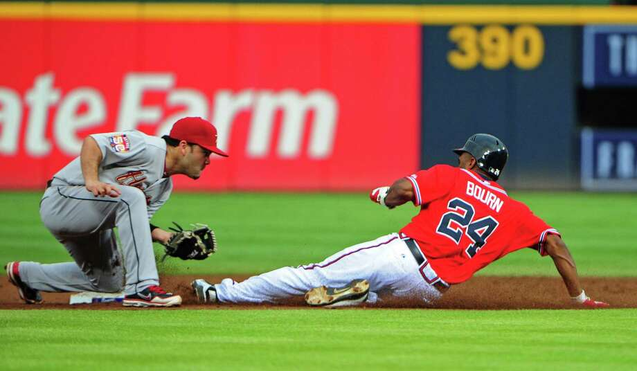 Aug. 3: Braves 4, Astros 1Michael Bourn steals second base against Jose Altuve.Record: 35-72. Photo: Scott Cunningham / 2012 Getty Images
