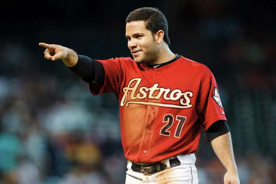 July 29: Astros 9, Pirates 5 Astros second baseman Jose Altuve points toward the dugout at the end of the fourth inning. With the win, the Astros snapped a franchise record 12-game losing streak.Record: 35-68. (Michael Paulsen / Chronicle) Photo: Michael Paulsen, Houston Chronicle / © 2012 Houston Chronicle