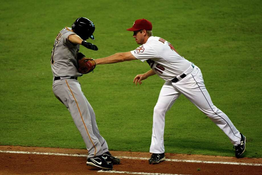 July 28: Pirates 4, Astros 3 Pirates pitcher Wandy Rodriguez is tagged out by Astros first baseman Matt Downs on a sacrifice bunt in the fifth inning. The Astros set a franchise record with their 12th consecutive loss.Record: 34-68. (Johnny Hanson / Chronicle) Photo: Johnny Hanson, Houston Chronicle / © 2012  Houston Chronicle