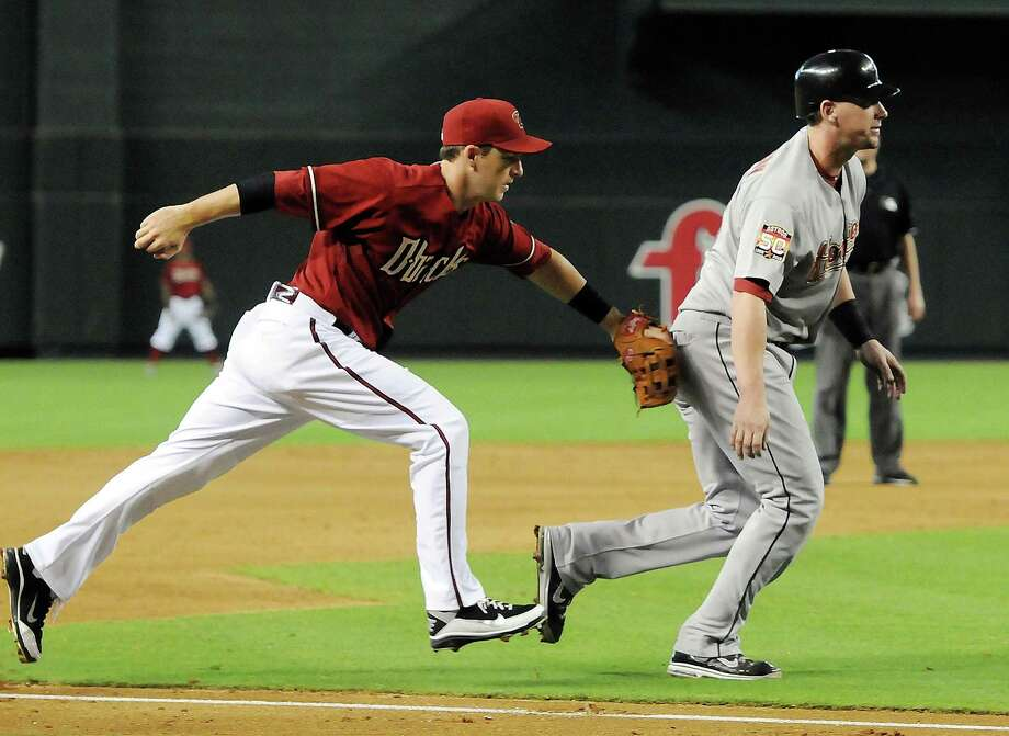 July 22: Diamondbacks 8, Astros 2 Diamondbacks third baseman Stephen Drew tags out Astros counterpart Chris Johnson. With the blowout loss, the Astros ended the 10-game road trip with a 1-9 record.Record: 34-62. Photo: Norm Hall, Getty Images / 2012 Getty Images