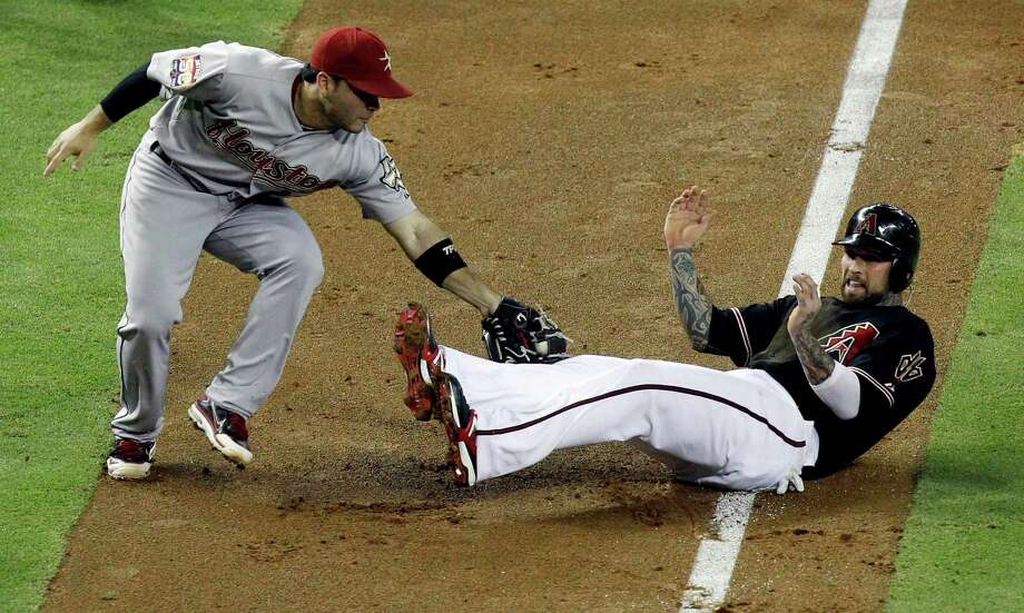 July 21: Diamondbacks 12, Astros 3 Ryan Roberts gets tagged out in a run down by Jose Altuve in the second inning.Record: 34-61. (Ross D. Franklin / Associated Press) Photo: Ross Franklin