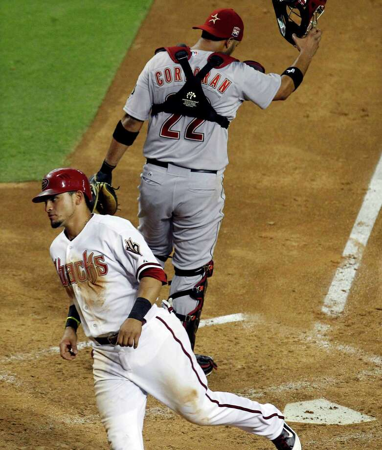 July 20: Diamondbacks 13, Astros 8The  Diamondbacks' Gerardo Parra, left, scores on a bases-loaded walk as the Astros' Carlos Corporan flips his catcher's mask off in frustration during the fifth inning.Record: 34-60. Photo: Ross D. Franklin, Associated Press / AP