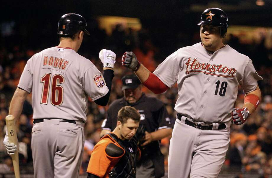 July 13: Giants 5, Astros 1 Chris Snyder, right, is congratulated by Matt Downs after hitting a solo home run off Giants pitcher Madison Bumgarner in the seventh inning. Snyder's solo shot provided the Astros' only run of the night.Record: 33-54. Photo: Ben Margot, Associated Press / AP