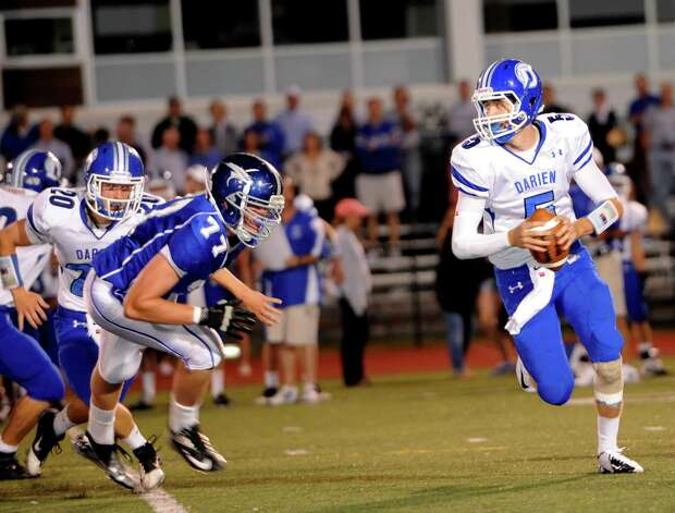 Darien high school quarterback Henry Baldwin looks for a receiver down field during the first football game of the 2012 season against Fairfield Ludlowe high school held at Fairfield Ludlowe high school, Fairfield, CT on Friday September 14th 2012 Photo: Mark Conrad / Connecticut Post Freelance
