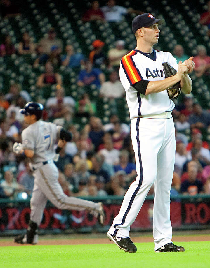 July 6: Brewers 7, Astros 1 J.A. Happ, right, looks on after giving up a home run to Norichika Aoki, left, during the first inning. Happ was tagged for seven runs on nine hits in 6 1/3 innings as the Astros lost their ninth straight game.Record: 32-52. Photo: Cody Duty, Houston Chronicle / © 2011 Houston Chronicle