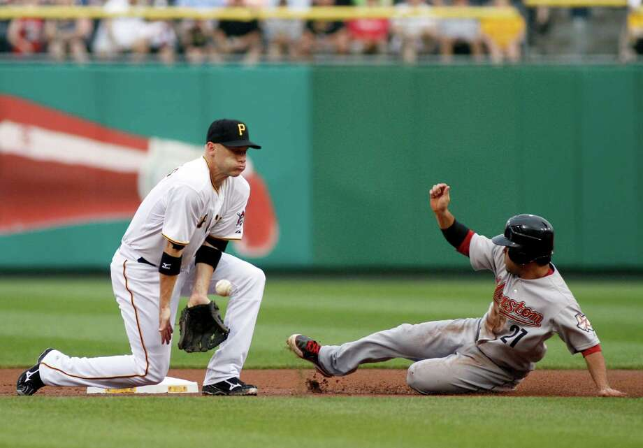 July 5: Pirates 2, Astros 0Astros second baseman slides in ahead of the tag by former Astros shortstop Clint Barmes. With the loss, the Astros ended the roadtrip with a 0-7 record.Record: 32-51. Photo: Justin K. Aller, Getty Images / 2012 Getty Images