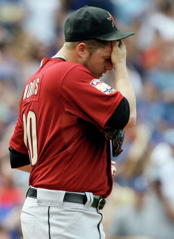 June 29: Cubs 4, Astros 0Bud Norris wipes his face after the Cubs' Luis Valbuena hit a solo home run during the second inning.Record: 32-45. Photo: Nam Y. Huh