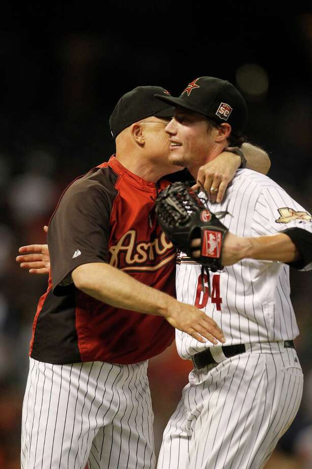 June 27: Astros 1, Padres 0 Astros manager Brad Mills congratulates Astros starting pitcher Lucas Harrell after his complete game shutout.Record: 32-43. (Karen Warren / Chronicle) Photo: Karen Warren, Houston Chronicle / © 2012  Houston Chronicle