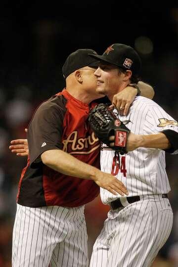 June 27: Astros 1, Padres 0 Astros manager Brad Mills congratulates Astros