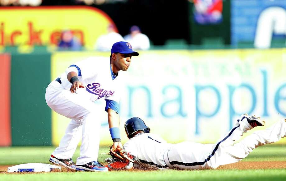 June 16: Rangers 8, Astros 3 Jordan Schafer is tagged out by Elvis Andrus. Record:  27-38 Photo: Rick Yeatts / 2012 Getty Images