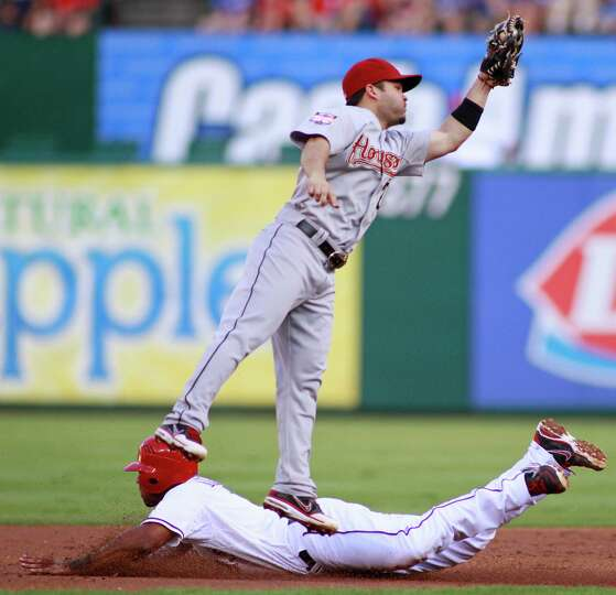 June 15: Rangers 6, Astros 2 Jed Lowrie leaps high for a throw from c