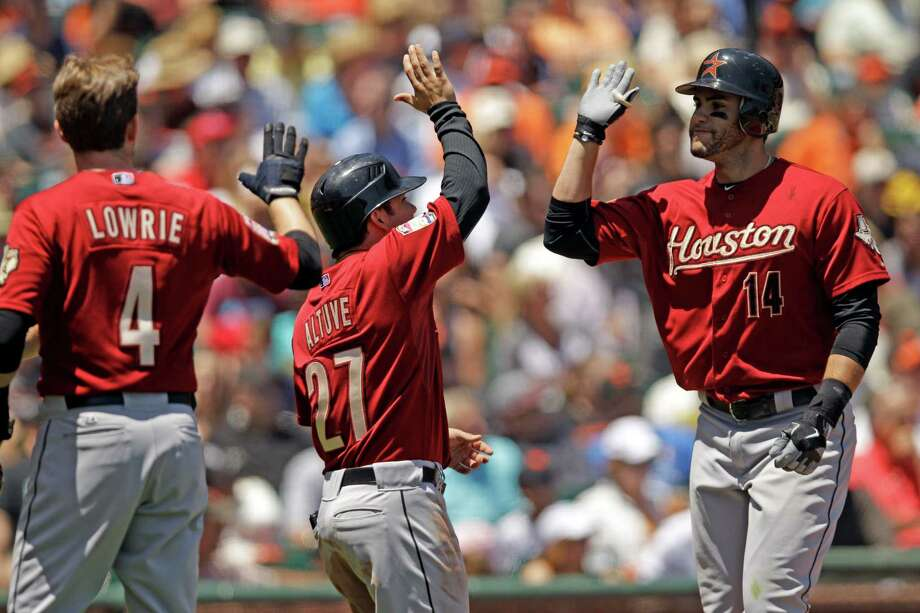 June 14: Astros 6, Giants 3J.D. Martinez celebrates his grand slam off  Giants pitcher Barry Zito with teammates Jose Altuve (27) and Jed Lowrie (4) during the third inning.Record: 27-36. Photo: Marcio Jose Sanchez