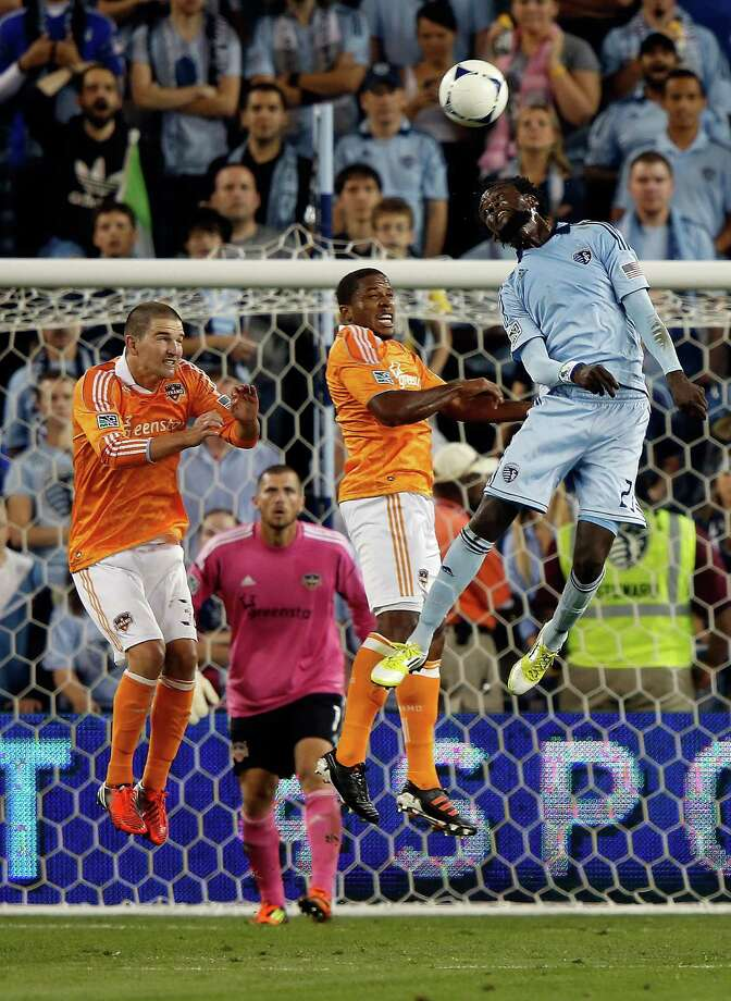 KANSAS CITY, KS - SEPTEMBER 14: Kei Kamara #23 of Sporting KC tries to head the ball as goalkeeper Tally Hall #1 of Houston Dynamo and defenders look on during the MLS game at Livestrong Sporting Park on September 14, 2012 in Kansas City, Kansas. Photo: Jamie Squire, Getty Images / 2012 Getty Images