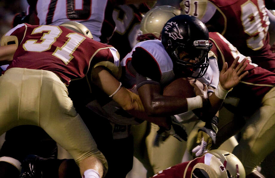 Langham Creek's Jeremiah Williams (28) comes out of the pile to score his second rushing touchdown of the game against Cy Woods at Pridgeon Stadium on Friday, Sept. 14, 2012, in Houston. Photo: Joe Buvid, For The Chronicle / © 2012 Joe Buvid
