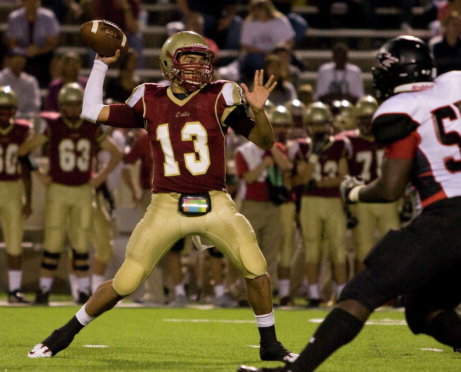 Cy Woods quarterback Nathaniel German (13) passes down the sideline to Mason Roberts for a first down just before half time against Langham Creek at Pridgeon Stadium on Friday, Sept. 14, 2012, in Houston. Photo: Joe Buvid, For The Chronicle / © 2012 Joe Buvid