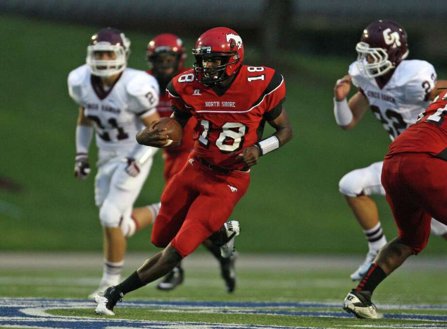 North Shore quarterback Micah Thomas (18) runs for a 59-yard touchdown against Cinco Ranch during the first half of a high school football game, Friday, September 14, 2012 at Galena Park I.S.D. Stadium in Houston, TX. Photo: Eric Christian Smith, For The Chronicle