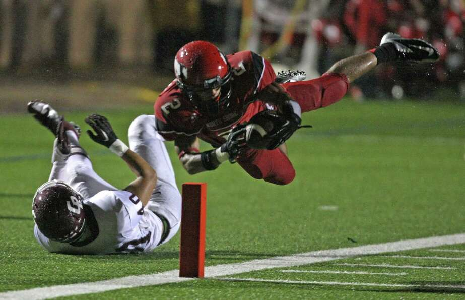 North Shore 62, Cinco Ranch 21North Shore's Kevin DeLeon (2) dives into the