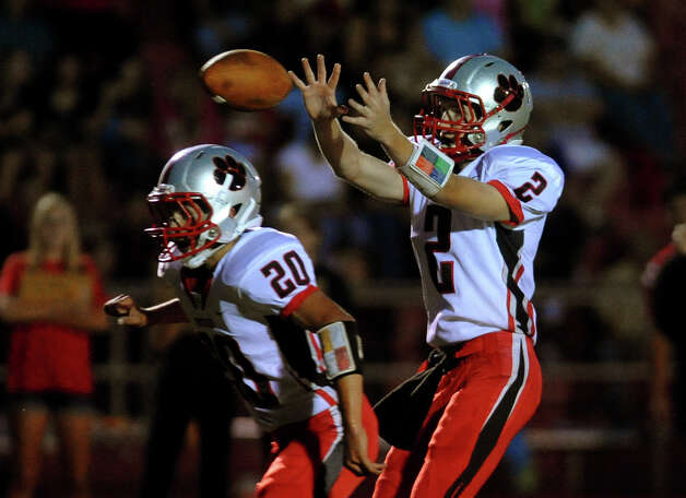 Pomperaug QB Eric Beatty recieves the snap, during boys football action against Masuk in Monroe, Conn. on Friday September 14, 2012. Photo: Christian Abraham / Connecticut Post