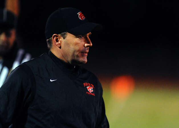Masuk Head Coach John Murphy, during boys football action against Pomperaug in Monroe, Conn. on Friday September 14, 2012. Photo: Christian Abraham / Connecticut Post