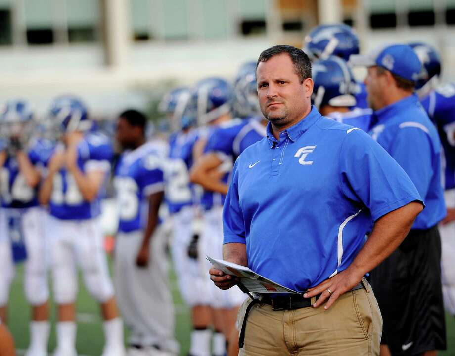 Fairfield Ludlowe high school head football coach Matt Mccloskey gets his team ready for the season opening football game against Darien high school held at Fairfield Ludlowe high school, Fairfield, CT on Friday September 14th 2012 Photo: Mark Conrad / Connecticut Post Freelance