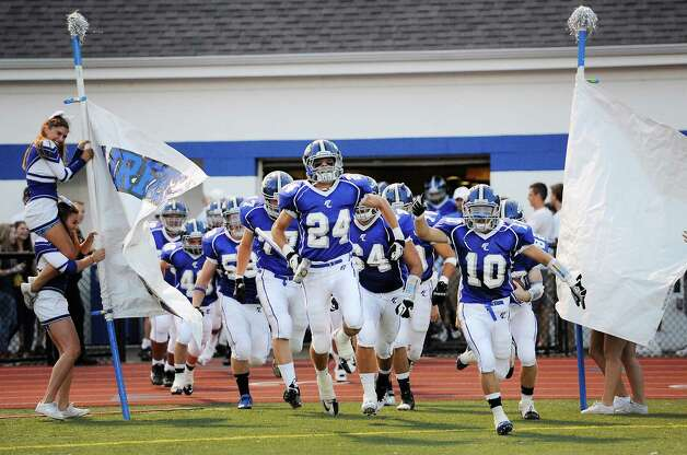 Fairfield Ludlowe high school's Brett Dammeyer leads the Falcon football team out onto the field in the season opening football game against Darien High School held at Fairfield Ludlowe high school, Fairfield, CT on Friday September 14th 2012 Photo: Mark Conrad / Connecticut Post Freelance